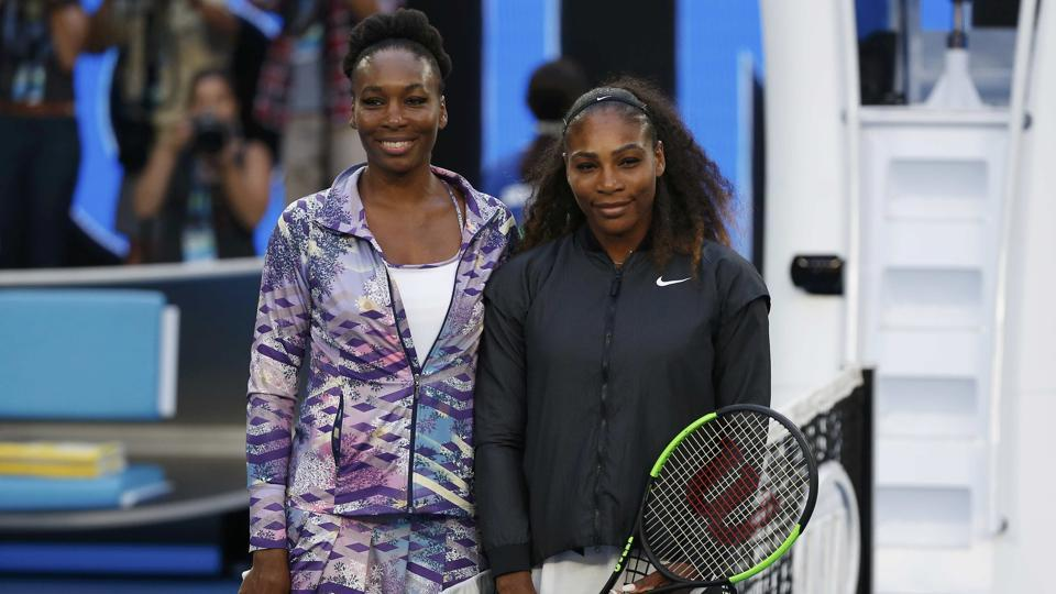 The Williams sisters pose for a photo ahead of their women's final  in Melbourne on Saturday.  (REUTERS)
