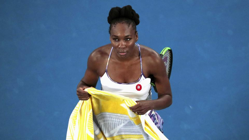 Venus is seen here watching a replay during her final against Serena Williams. (REUTERS)