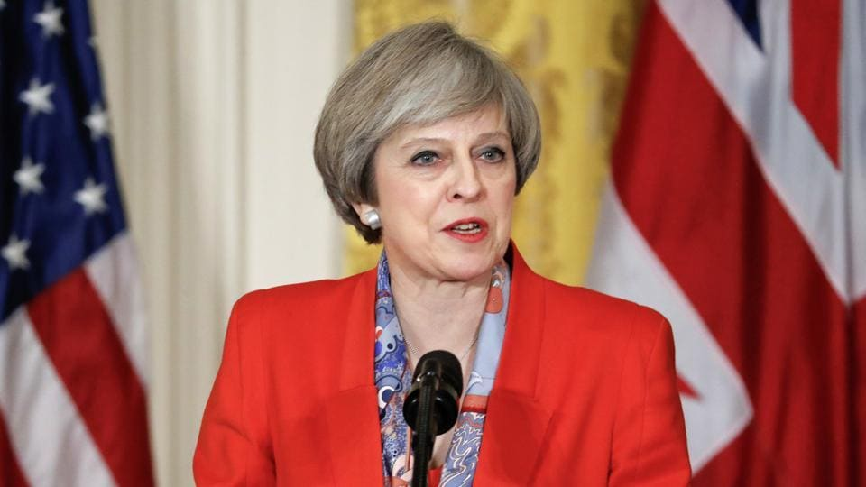 British Prime Minister Theresa May speaks during a news conference with President Donald Trump on Friday in the East Room of the White House in Washington.