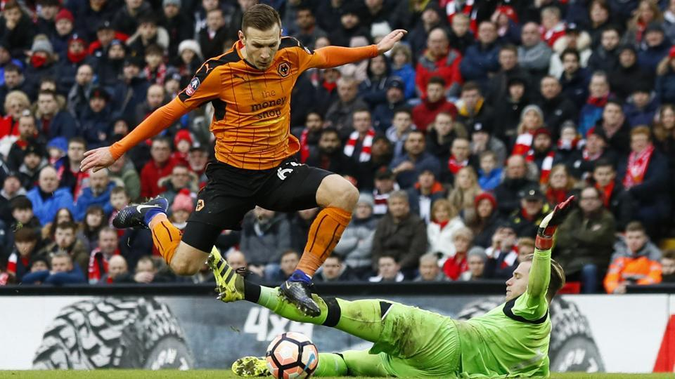 Wolverhampton Wanderers' Andreas Weimann scores their second goal against Liverpool F.C. in their FACup fourth round match on Saturday.