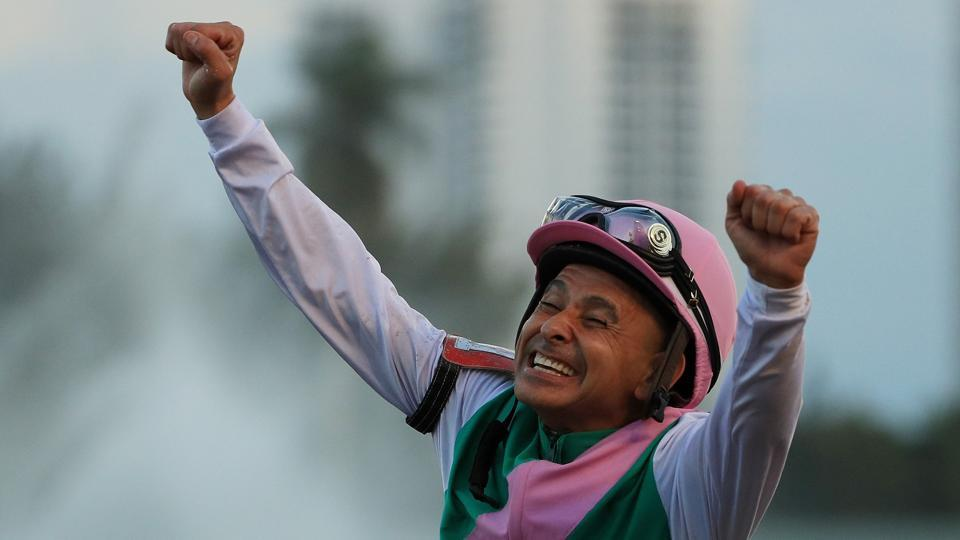 Jockey Mike Smith celebrates atop Arrogate after winning the $12 Million Pegasus World Cup Invitational at Gulfstream Park on January 28, 2017 in Hallandale, Florida.  (Mike Ehrmann/ / AFP)