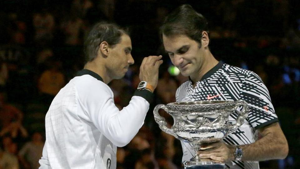 Roger Federer is congratulated by Rafael Ndal on his fifth Australian Open triumph.
