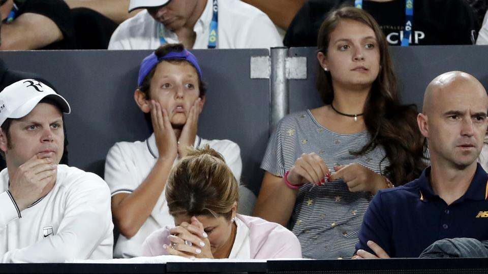 Mirka Federer (centre) can't handle the pressure of watching her husband play, in Melbourne on Sunday. (AP)