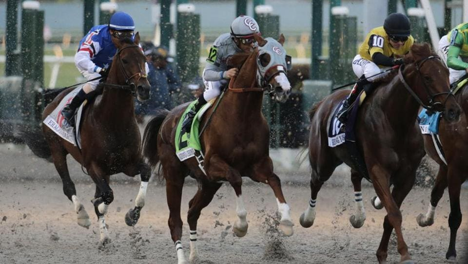 Jockey Victor Espinoza rides California Chrome (12) out of the starting gate in the inaugural running of the $12 million Pegasus World Cup horse race at Gulfstream Park, Saturday, Jan. 28, 2017, in Hallandale Beach, Florida. At left is jockey Edgar Prado riding Eragon (11) and at right jockey Luis Contreras riding Breaking Lucky (10).  (Lynne Sladky / AP)