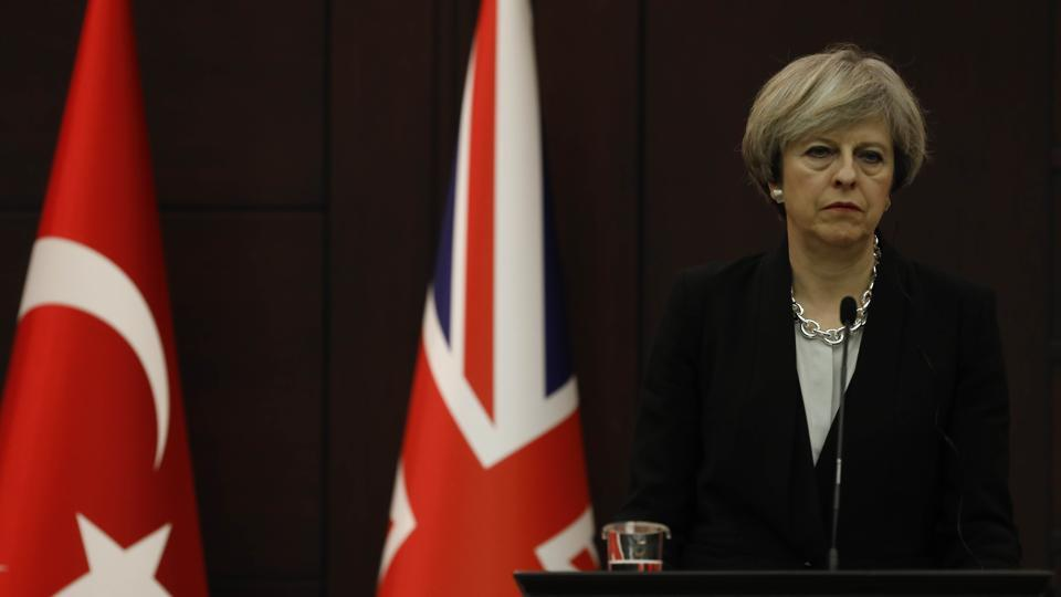 Britain's Prime Minister Theresa May listens to her Turkish counterpart Binali Yildirim (not pictured) during a joint news conference in Ankara, Turkey.