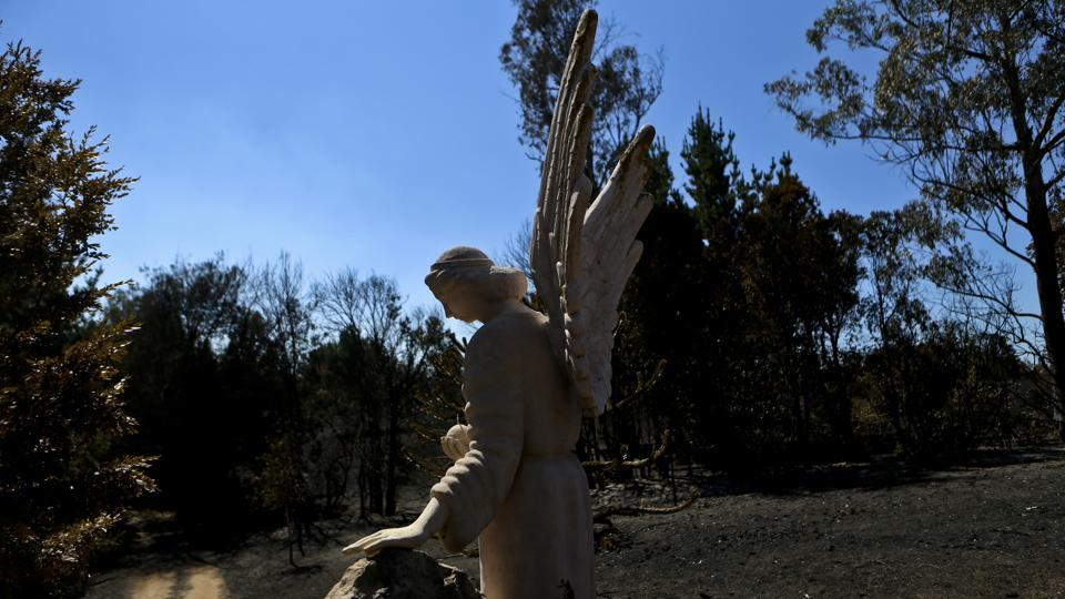 The sculpture of an angel stands at the entry of a house that was consumed by a forest fire in Florida, Chile, Saturday, Jan. 28, 2017.  (Esteban Felix / AP)