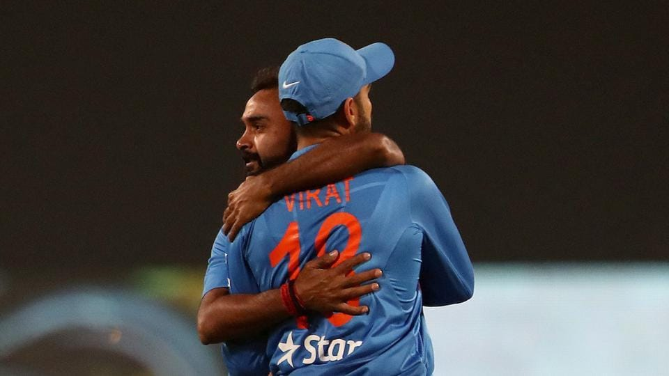 Amit Mishra celebrates the wicket of Eoin Morgan with India captain Virat Kohli during the 2nd T20I in Nagpur on Sunday.