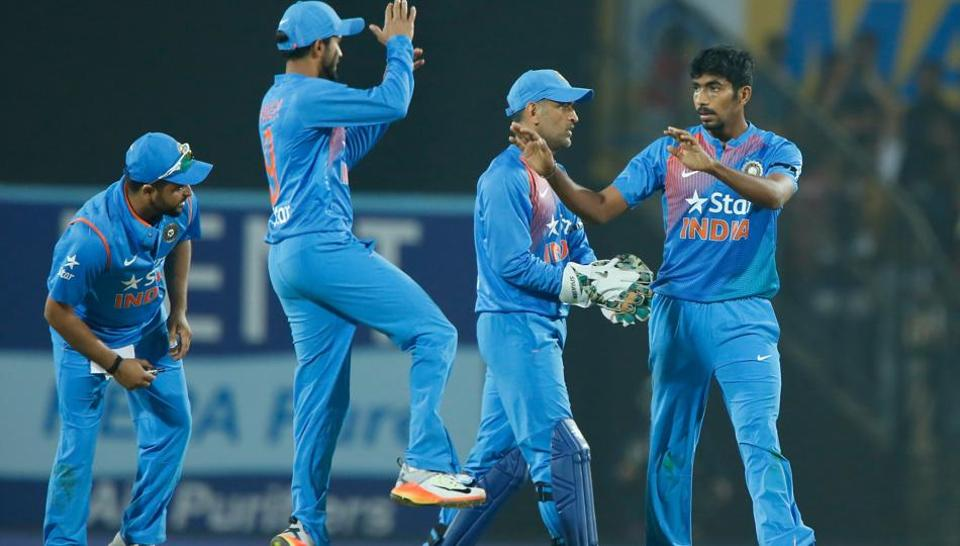 Jasprit Bumrah (right) celebrates after bowling a brilliant last over to guide India to a five-run win over England and level series 1-1. (BCCI)