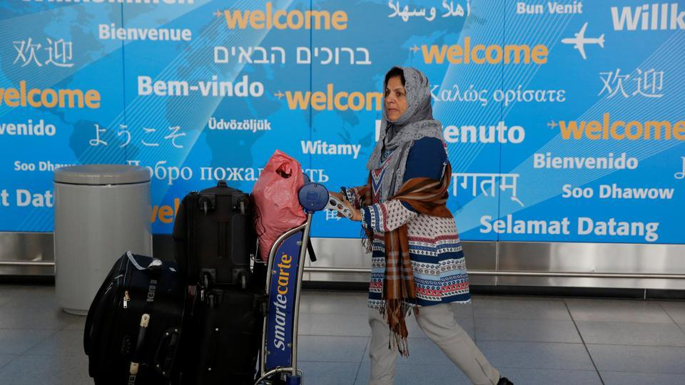 A woman exits immigration after arriving from Dubai on Emirates Flight 203 at John F Kennedy International Airport in Queens, New York.