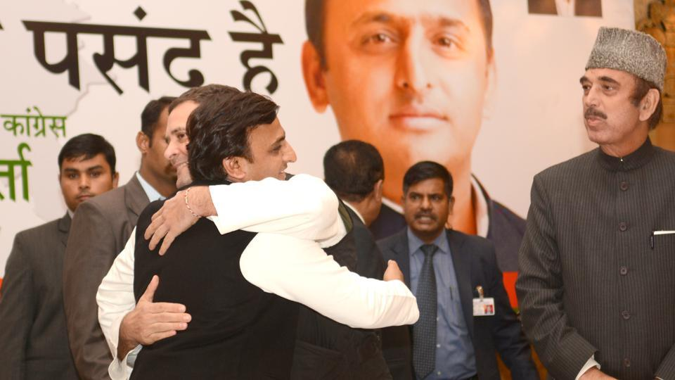 Congress vice-president Rahul Gandhi and Samajwadi Party national president Akhilesh Yadav hug each other during the joint press conference in Lucknow, India.