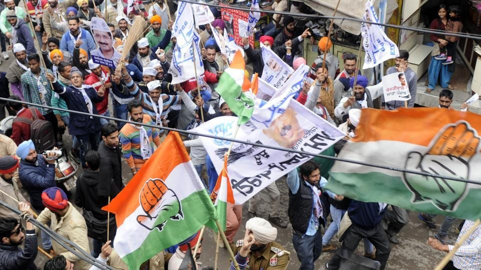 Congress workers and AAP supporters crossing paths during a roadshow in Patiala on Friday.
