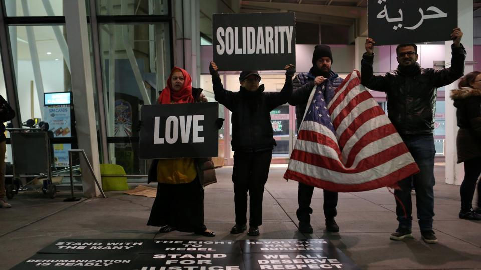 Protesters outside the JFK airport in Queens, New York City on Sunday.