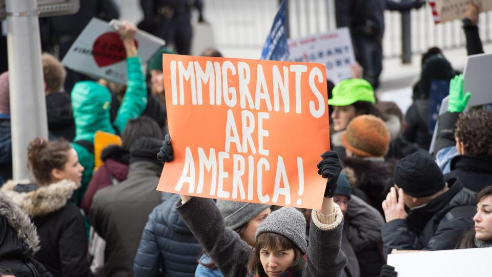 Protesters gather at JFK International Airport's Terminal 4 to demonstrate against President Donald Trump's executive order in New York.