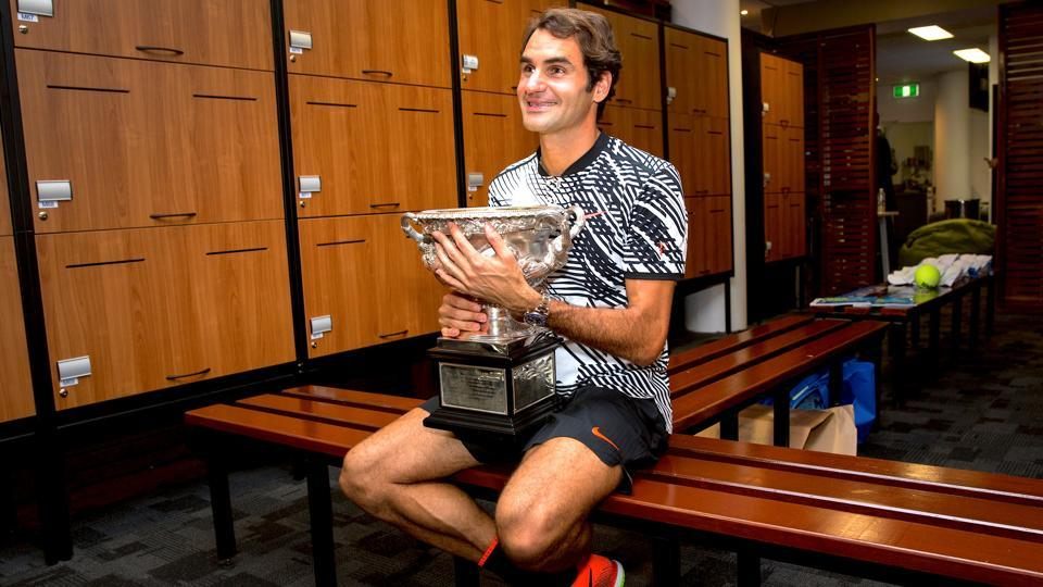 Switzerland's Roger Federer with his prize, the Norman Brookes Challenge Cup, after beating Rafael Nadal in the final to win the Australian Open on Sunday.