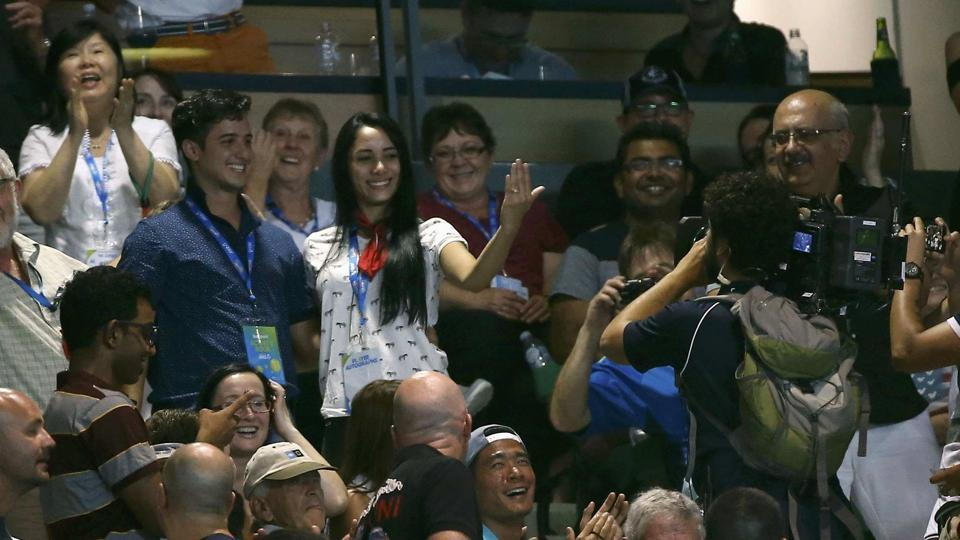 Meanwhile, a wedding proposal is seen in the crowd during the Australian Open final on Sunday.  (REUTERS)