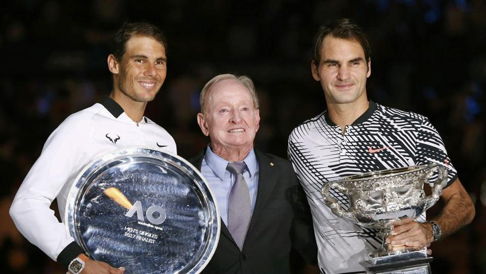 Roger Federer (right) and Rafael Nadal (left) pose with Australian great Rod Laver.  (REUTERS)