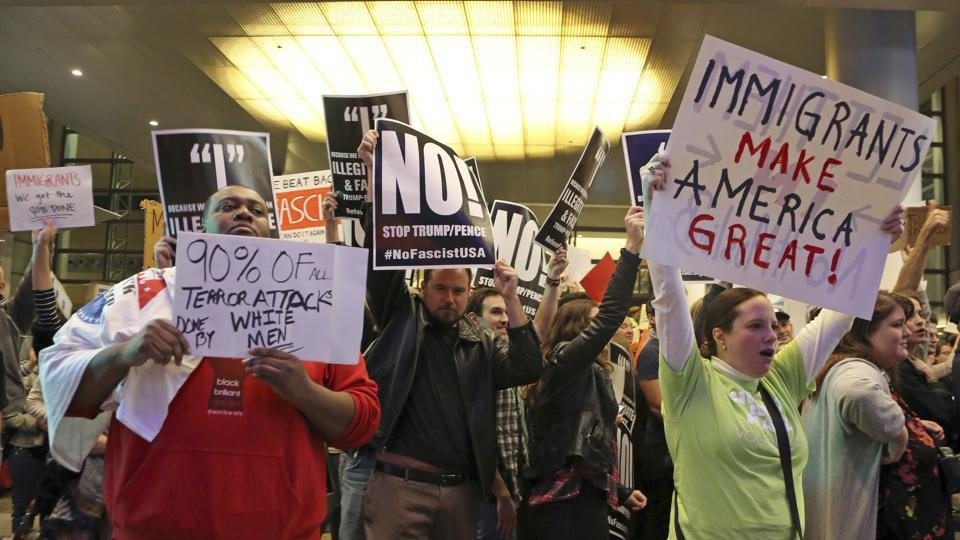 People protest President Donald Trump's executive order barring entry into US from seven countries, which are predominantly Islamic nations, at Los Angeles International Airport on January 28, 2017.
