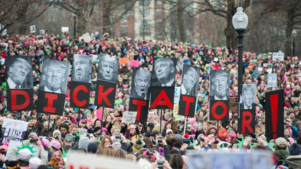 Protesters march across Boston Commons during the Boston Women's March for America on January 21, 2017. Led by women in pink