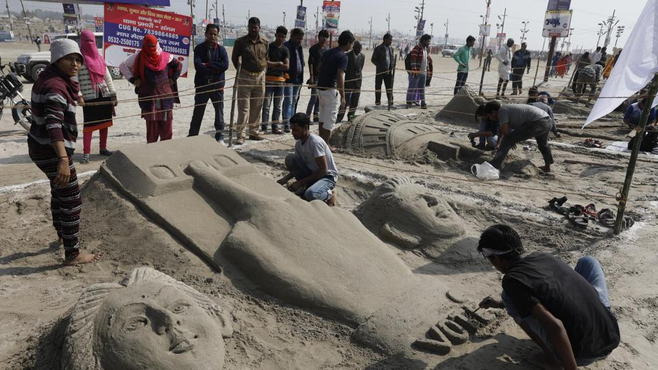 Sand artists making sculptures at the Magh Mela in Allahabad on Sunday.