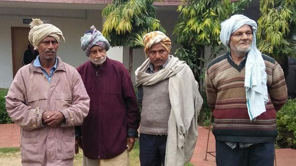 Mukhtiar Rai (left, in light brown jacket) was united with his father and his brother from Bihar's Chhapra  by tea-seller Nandlal Modi (right, in striped sweater) at Mukundgarh in Rajasthan's Jhunjhunu district.