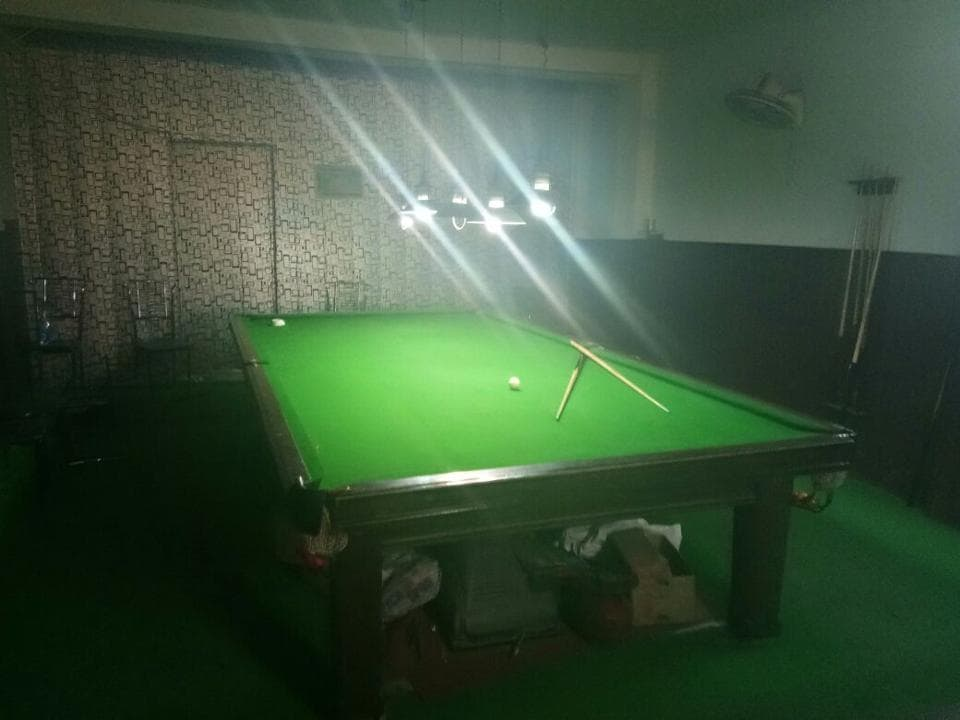 Customers would place bets on the number of points they would win in a game of snooker.
