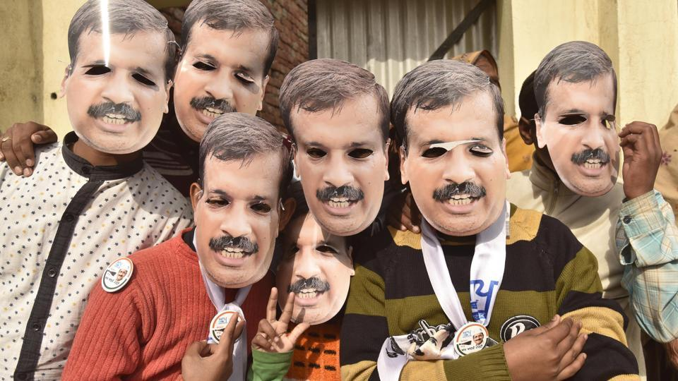 KEJRI CHOIR: Youths wearing Arvind Kejriwal masks during a rally in Majitha on Sunday.