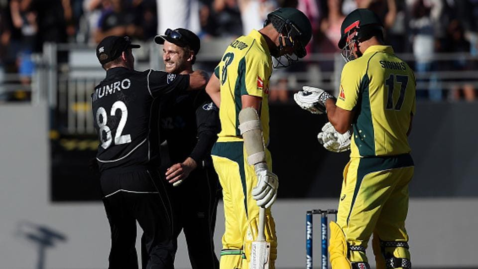 New Zealand's Kane Williamson (2nd L) and Colin Munro (L) celebrate after winning the match as Australia's Josh Hazlewood (second R) and Marcus Stoinis (R) look on during the one-day international (ODI) in Auckland.