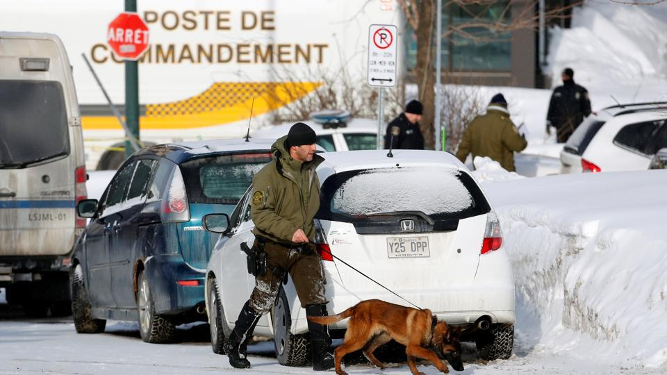 Police officers patrol the perimeter at the scene of a fatal shooting at the Islamic Cultural Centre of Quebec in Quebec City, Canada, on January 30, 2017.