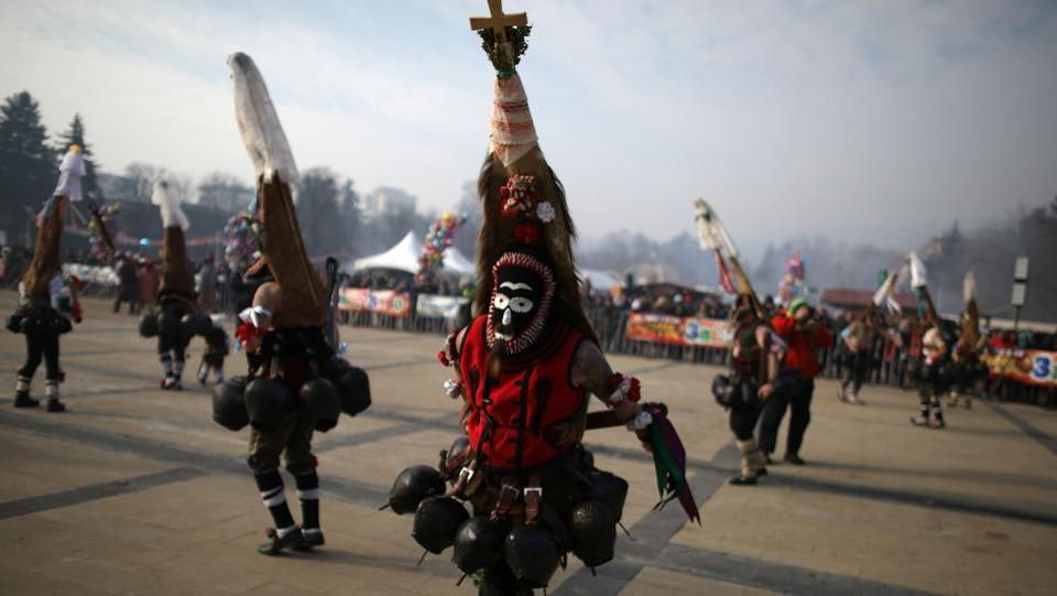 Dancers wearing masks take part in the International Festival of Masquerade Games on Sunday.  The three-day festival, which started on Friday, has participants sporting multi-coloured masks, covered with beads, ribbons and woolen tassels while the main dancer, ladened with bells to drive away sickness and evil spirits, sways like a wheat spikelet heavy with grain.  (REUTERS)
