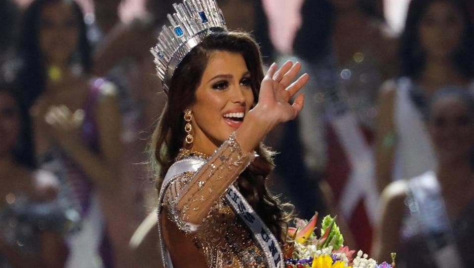 Miss France Iris Mittenaere waves after being declared winner in the Miss Universe beauty pageant in Manila.