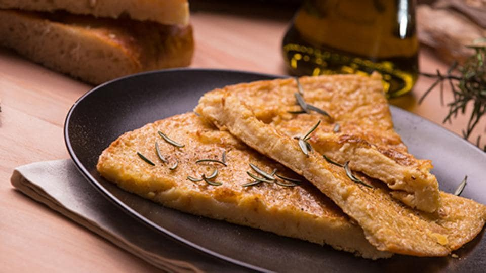 Farinata, Italy: This Genoan recipe is a veritable institution in Italy. Farinata is a savory pancake made from chickpea flour, water, salt and oil, which is cooked in a wood-fired oven. Each region has its own variants and preferences for Farinata, which can be eaten with pesto or gorgonzola, spread on the pancake straight from the oven. (Istock.com)