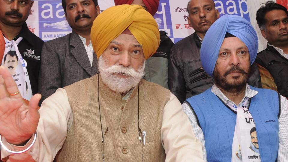 Former Congress leader Bir Devinder Singh with AAP's Patiala Urban candidate Dr  Balbir Singh on Monday.