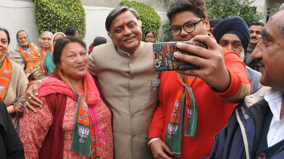 BJP candidate Manoranjan Kalia  with his supporters in Jalandhar on Sunday,