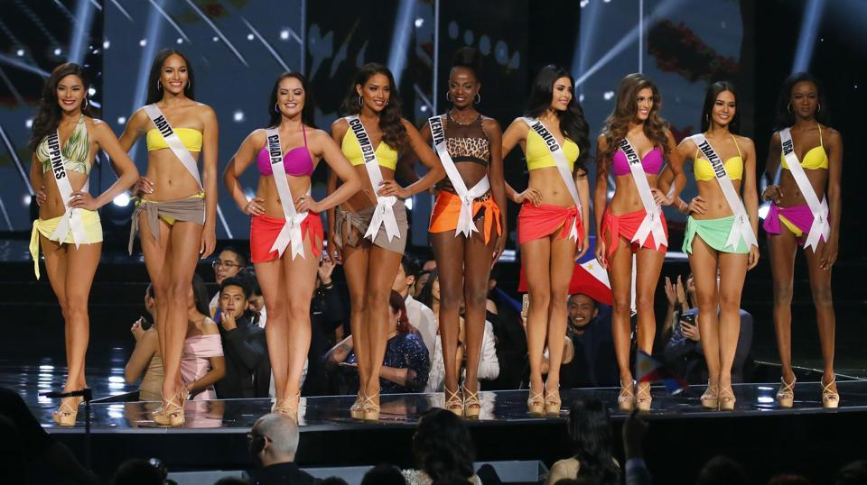 The contenders were  trimmed to nine, including local hopeful Maxine Medina, who overcame a torrent of domestic criticism of her public-speaking skills. From left, Maxine Medina of the Philippines, Raquel Pelissier of Haiti, Sierra Bearchell of Canada, Andrea Tovar of Colombia, Mary Were of Kenya, Kristal Silva of Mexico, Iris Mittenaere of France, Chalita Suansane of Thailand and Deshauna Barber of the United States.  (AP)