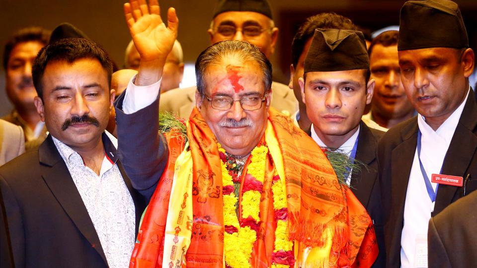 "Nepal' Prime Minister Pushpa Kamal Dahal ""Prachanda"" waves towards the media after he was elected in Kathmandu on August 3, 2016."