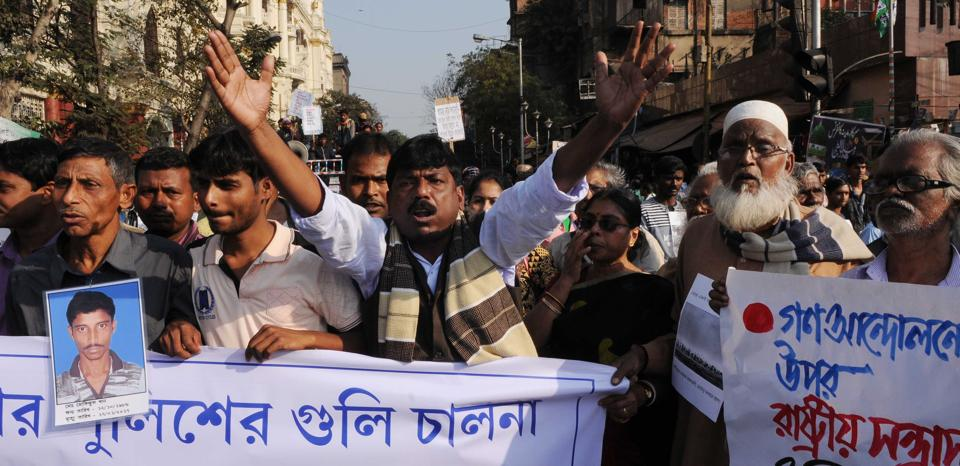 Sukur Ali Khan (extreme left), father of Mafizul Ali Khan, who was shot dead at Bhangar, walking with fellow villagers at a rally called by Naxalites in Kolkata.