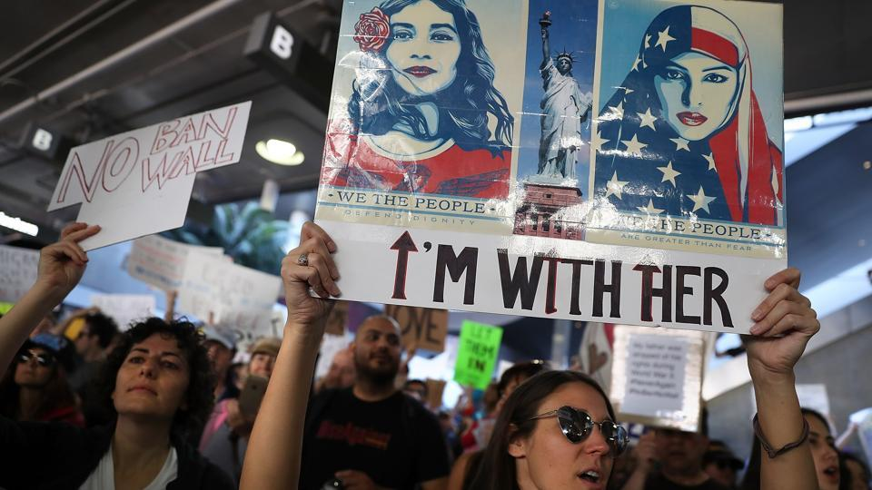 Protesters hold signs during a demonstration against the immigration ban that was imposed by US President Donald Trump at Los Angeles International Airport. (Justin Sullivan/AFP)