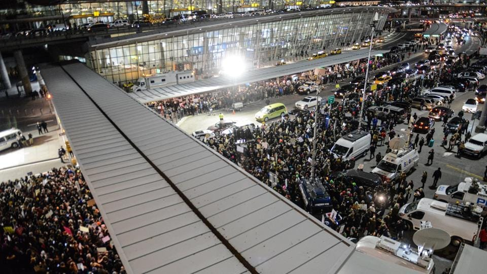 Protestors rally during a demonstration against the new immigration ban issued by President Donald Trump at John F Kennedy International Airport.
