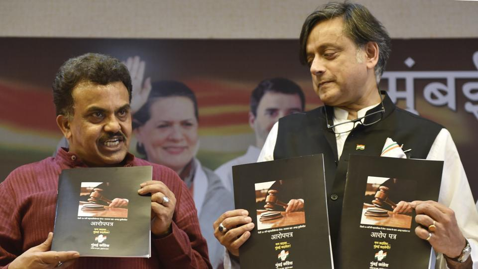 Mumbai Congress chief Sanjay Nirupam  (left) with party leader Shashi Tharoor releasing a 'chargesheet', about the 20-year Shiv Sena-Bhartiya Janata Party rule in the Brihanmumbai Municipal Corporation, on Monday.
