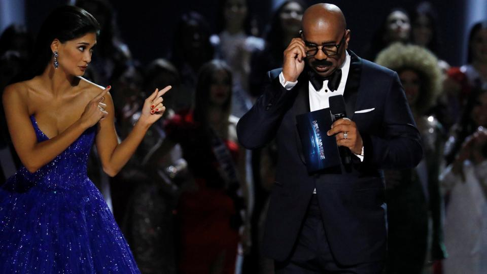 Outgoing Miss Universe Pia Wurtzbach gestures towards emcee Steve Harvey shortly before the winner of the 65th Miss Universe beauty pageant is announced. Harvey returned as show host after a gaffe in the 2015 competition, when he mistakenly announced the wrong winner. (REUTERS)
