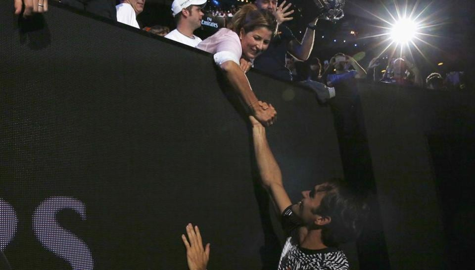 Roger Federer celebrates with wife Mirka after winning his fifth Australian Open title. (REUTERS)