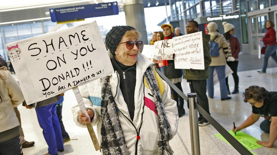 Deanna Culley gets ready for a protest against President Donald Trump's executive order temporarily suspending all immigration for citizens of seven majority Muslim countries for 90 days at the Indianapolis International Airport. (Kelly Wilkinson/AP)