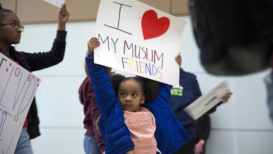 Deana Stevenson, 5, protests President Donald Trump's immigration order during a rally at McCarran International Airport in Las Vegas. (Steve Marcus/AP)