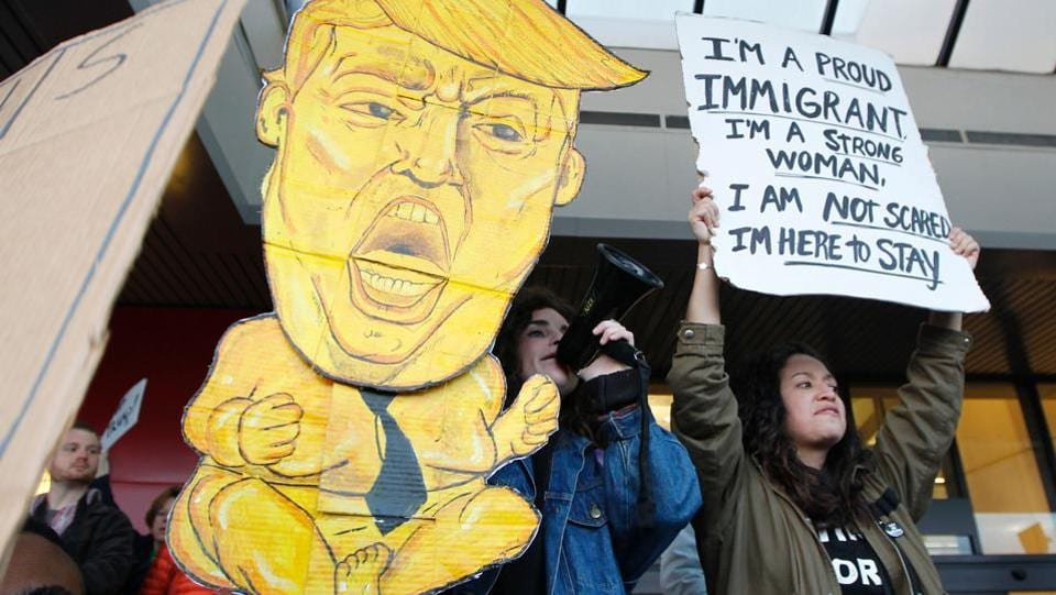Protestors crowd the sidewalks at Hartsfield–Jackson Atlanta International Airport to denounce US President Donald Trump's executive order. (Tami Chappell/AFP)