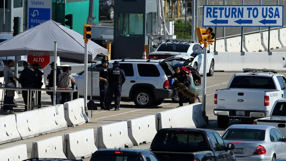 US Customs and Border Patrol agents stop traffic heading into Mexico to check vehicles leaving the country in San Ysidro, California, US, on January 25, 2017.
