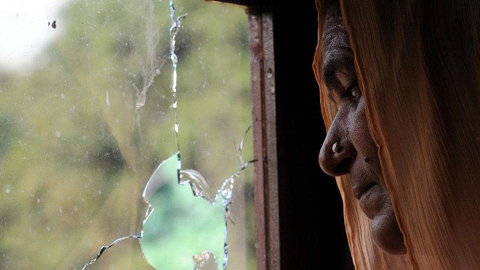 A villager standing near broken glass during heavy shelling from Pakistan side at India-Pakistan International border in Jammu at Pargwal sector, Akhnoor.