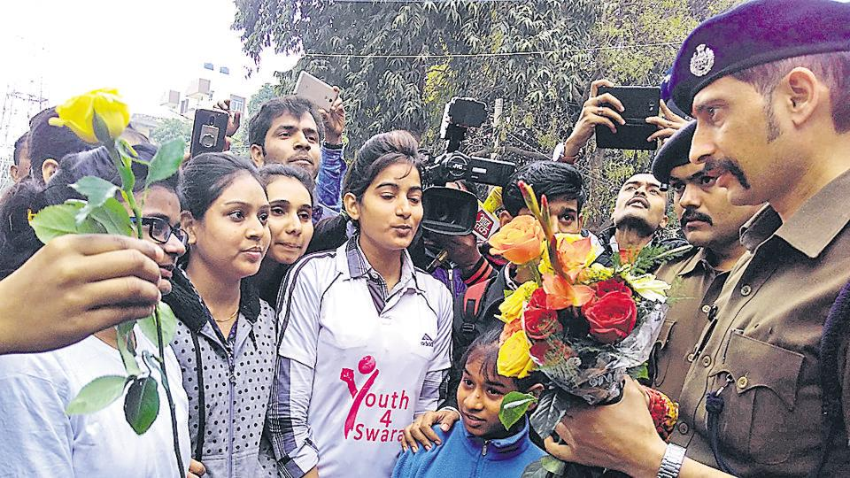 Patna senior superintendent of police Manu Maharaaj (right) receiving roses from college students in Patna.