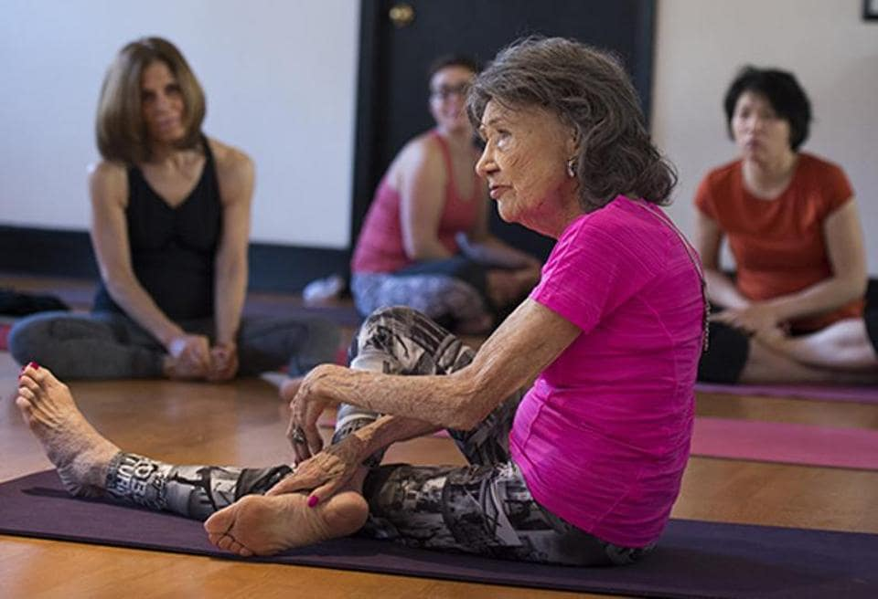 Yoga master Tao Porchon-Lynch instructs a yoga class.