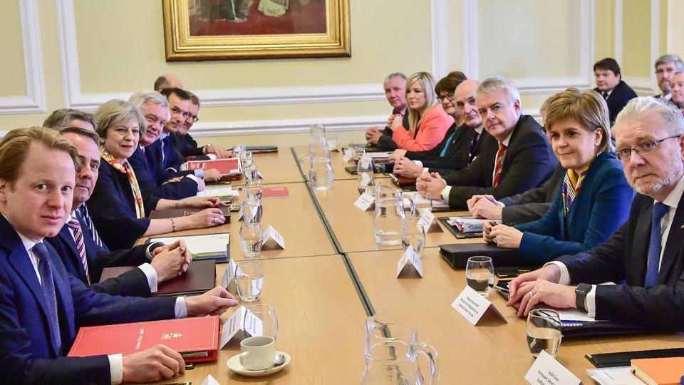 British Prime Minister Theresa May (4L) with members of her Cabinet as she prepares to chair a joint ministerial committee in Cardiff.