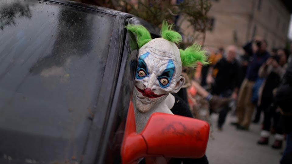A masked reveller looks out from a car during carnival celebrations in Ituren.  (REUTERS PHOTO)